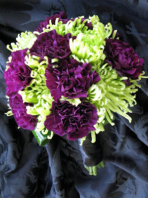 color scheme with the mums and the darkest purple Florigene carnations