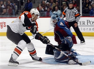 Simon Gagne puts a penalty shot past Andrew Raycroft of the Colorado Avalanche