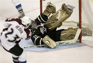 Milan Hejduk of the Colorado Avalanche scores on Marty Turco of the Dallas Stars