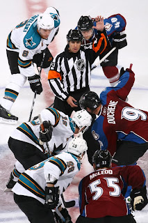 Matt Duchene faces off against Patrick Marleau on opening night