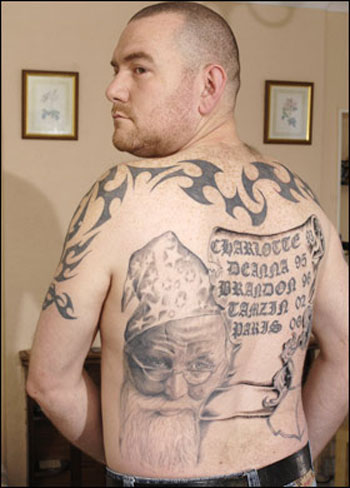 Man tattoos face and bod