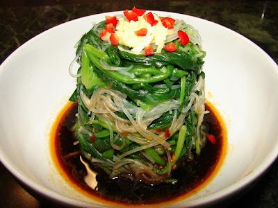 sichuan style salad with spinach and glass noodles eaten warm or cold ...