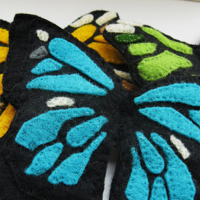 large bright blue butterfly brooch made from felt