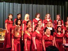 Brianne singing in the girls choir at school
