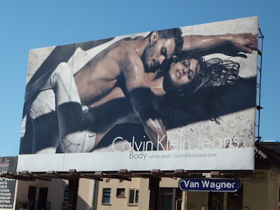 Calvin Klein white wash jeans billboard