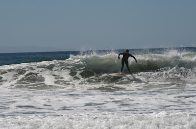 Surfer catching waves
