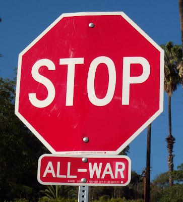 STOP ALL WAR street sign