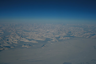 Coast of Greenland from above the clouds