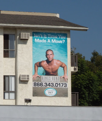 Hot swimming pool guy billboard