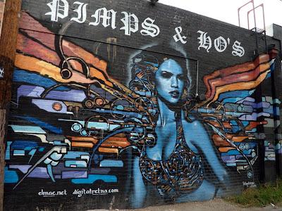 Alley graffiti angel