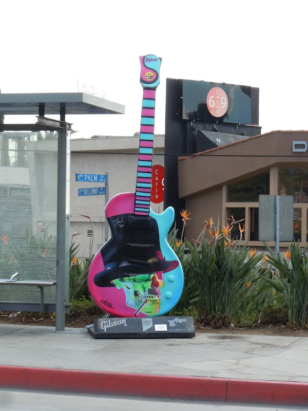 Ron English Slash GuitarTown sculpture