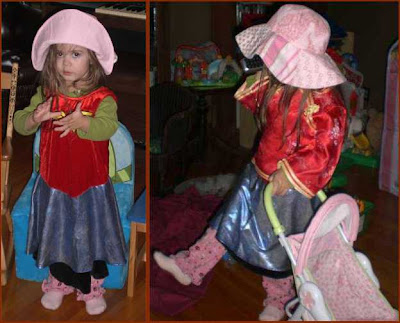 Preschooler playing dress-up.