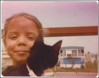 Preschooler with her cat, vintage photo from 1978.
