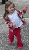 My daughter grooving in her pink sweater.