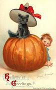Vintage Jack O'lantern with children dressed in Halloween costumes.
