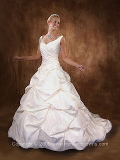 a white Romantic Gowns wedding gown