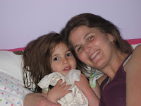 Alyson Rosenberg and her four-year-old daughter Rachel cuddle