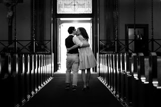 black and white photo of a couple exiting the church