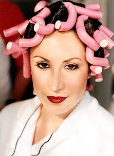 portrait of a bride with pink curlers in her hair