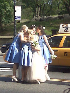 A photo of a bride, bridesmaids, flowergirl, groom and his groomsmen standing on a Manhattan street and a photo of a bride hugging her bridesmaids and flowergirl in front of a taxi in a Manhattan street
