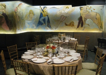 round table formally set with flower centerpiece