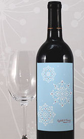 Wine bottle with blue sticker on it and a wine glass next to it