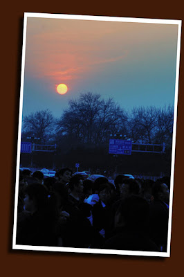 sunset and tiananmen square crowd
