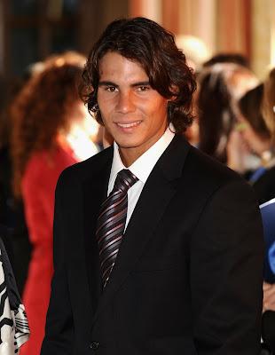 rafael nadal arms. a dapper Rafael Nadal made