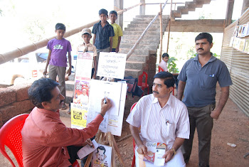 cartoonist MR. VENKAT BHAT EDANEERU AT TULU AYANO-2009 HELD AT KASARAGOD,BADIYADKA