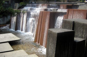 Water cascades down stone blocks in this striking Portland fountain.