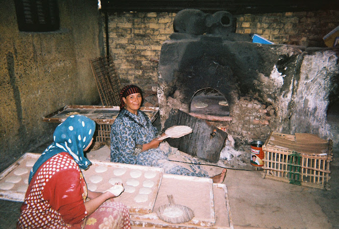 Egyptian Women Making Pita Bread