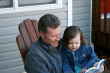 NAMC montessori values peaceful home life father and daughter reading