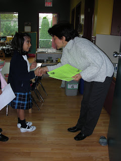 girl shaking hands with NAMC montessori teacher the goals of montessori education