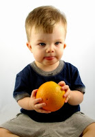 NAMC montessori classroom infant toddler circle time activities boy with orange