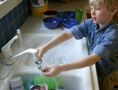 NAMC montessori practical life activities home classroom boy washing hands