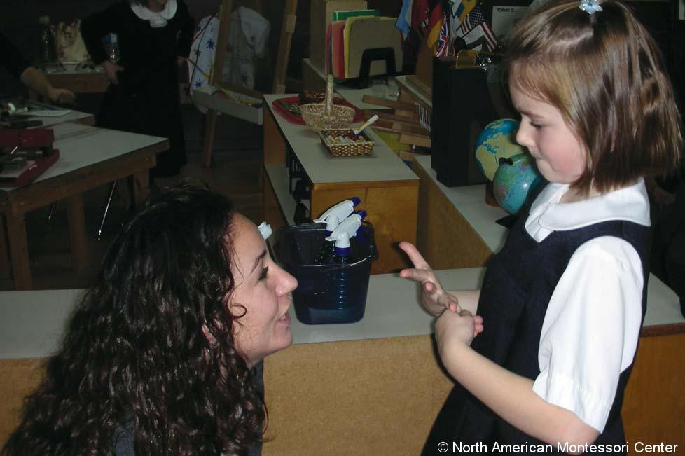 Gluing Redirecting Behavior NAMC Montessori Classroom Working Towards Normalization teacher girl