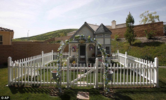 Life of luxury: Tammy Kassis' 11-foot tall Victorian doggie mansion ...