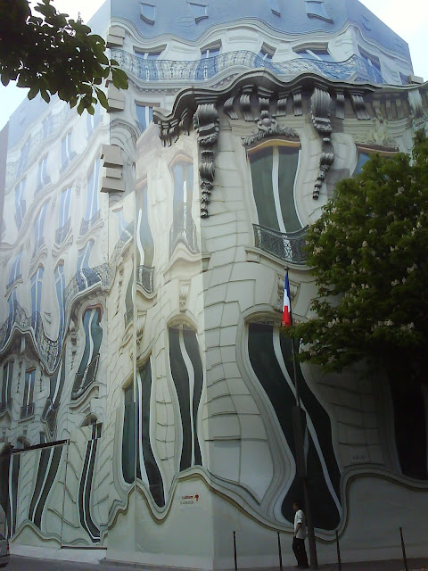 a trompe-l'oeil, is located in Georges V Ave. in Paris, France.