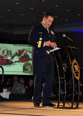Rear Adm. Michael Parks, commander of the Ninth Coast Guard District, delivers the keynote address during the 92nd Annual Traverse City Chamber of Commerce Dinner, Jan. 28, 2011. U.S. Coast Guard photo by Petty Officer 3rd Class George Degener