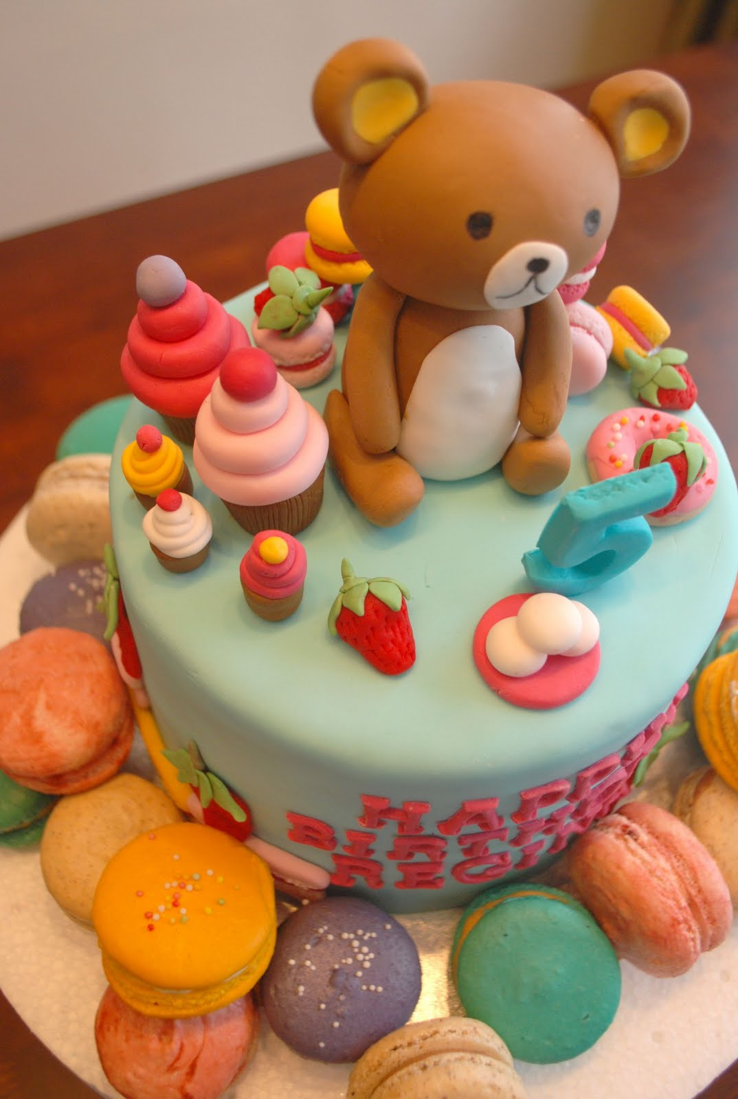 Rilakkuma Likes Eating Sweets And Cakes So We Surround With All Things She Loves As Well A Stack Of Macarons Along The Side