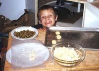 Henry Making Baked Cheddar Olives c 1998