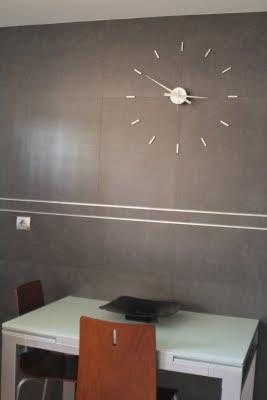 OJ Nomon, reloj de pared