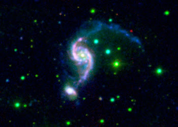 An Older Galaxy Pair has a Surprisingly Youthful Glow
