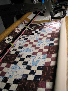 """Quilt with """"swishing cat tail"""" design on top, quilted by Angela Huffman"""