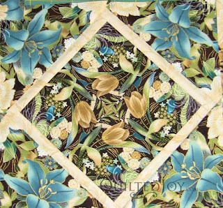 Four Patch Posie Supreme, quilted by Angela Huffman