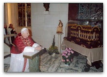 The Pope venerating the relics of St Therese