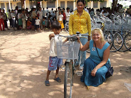 Boy Receives Rotary Bike