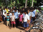 Children Line Up to Receive Rotary Bikes!