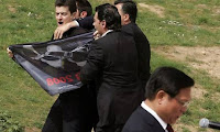 tibet protesters disrupt olympic flame ceremony