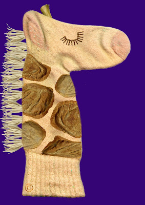 Giraffe hand puppet made by Necky Becky middle child of the Neckmann family of Giraffe World by Ingrid Sylvestre North East artist writer and entertainer Durham UK